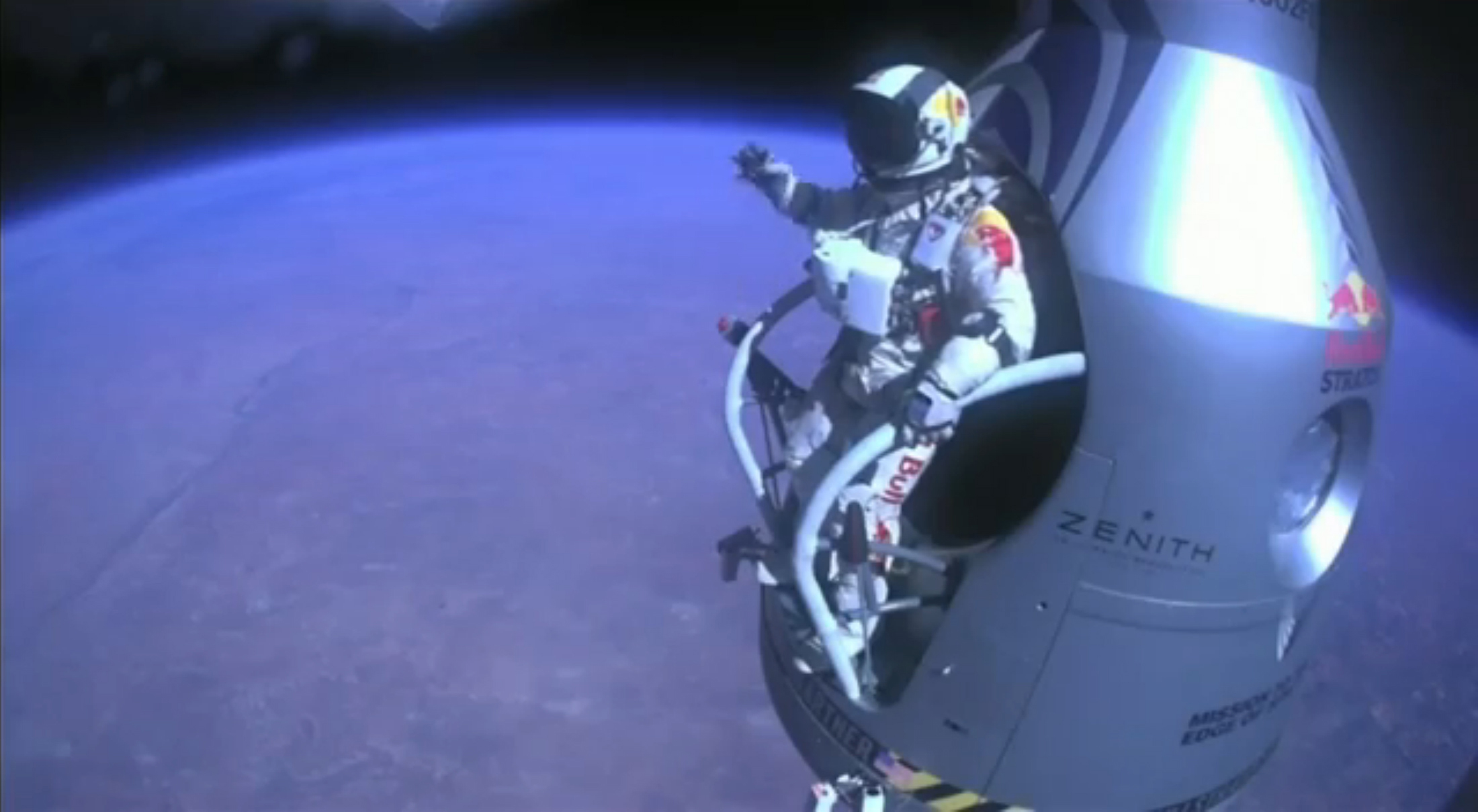 Handout of pilot Felix Baumgartner of Austria exiting his capsule as he begins his record-setting skydive over Roswell